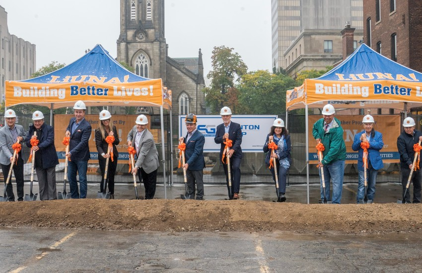 Eleven attendees with shovel at 75 James groundbreaking event